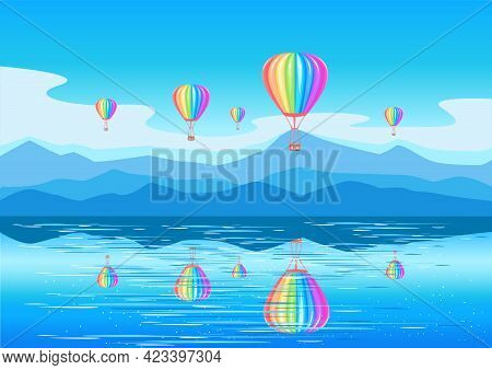 Aerostats Of Rainbow Colors Fly Over The Sea And Are Reflected In The Water. Balloon In The Colors O
