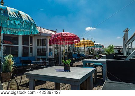 Ijmuiden, The Netherlands, May 30, 2021, Colorful Indian Parasols On A Terrace Of A Beach Club On A