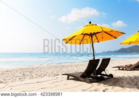 Beach Chairs With Yellow Umbrella And Beautiful Sand Beach In Koh Samui, Thailand. Vacation Holidays