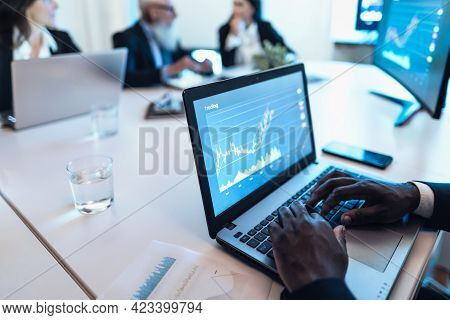 Business Stock Traders People In Meeting Room Working On Crypto Currency Markets With Blockchain Tec