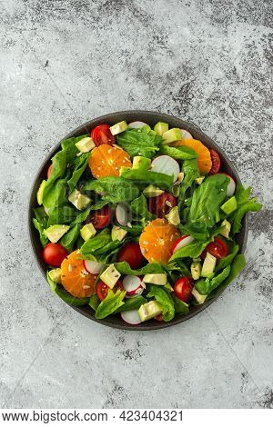 Delicious Healthy Salad Of Spinach Leaves, Tangerine And Avocado Slices, Tomato And Radish With Seed