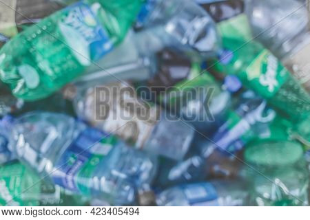 Blurred Background Of Plastic Waste, Recycling And Recycle Garbage.