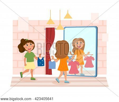 Two Little Girls Are Trying On Clothes Together In A Store. Cute Children Looking In The Clothes Sto