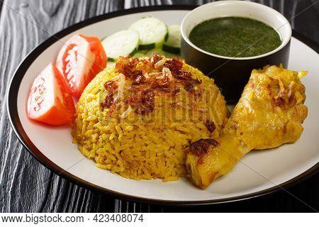 Tasty Khao Mok Gai Thai Rice And Chicken Biryan Closeup In The Plate On The Table. Horizontal