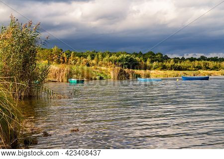 Small Open Colorful Rowboats Moored On Water. Post-mining Reservoir (artificial Lake) Pogoria Iv Bef