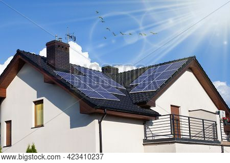 Modern House With Solar Panels On The Roof.