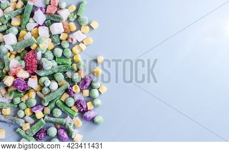 Frozen Vegetables On A Colored Background Top View. Food Concept In The Pandemic Frozen Vegetables K