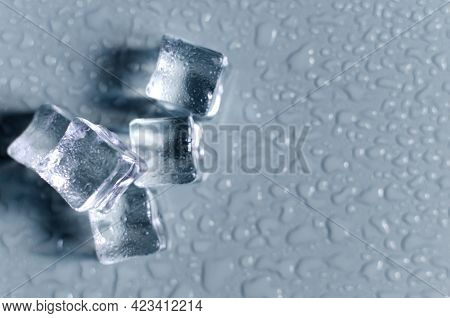 Transparent Ice Cubes On The Light Background Of The Mine Space. Background Of Transparent Ice Cubes