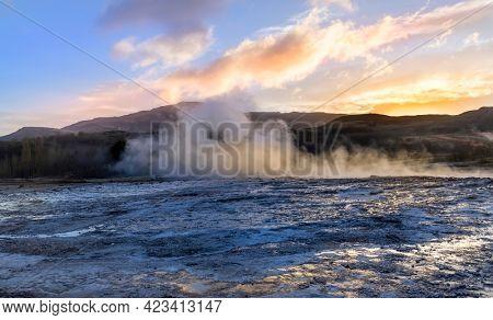Geothermal activity at Geyser in Iceland under evening sun light