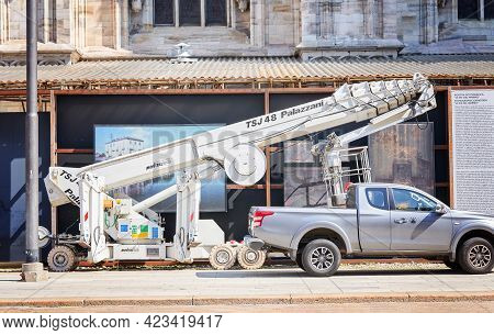 Milan, Italy - July 7, 2020. Car And Scissor Lift Platform With Hydraulic System, Lifting Machine Ne