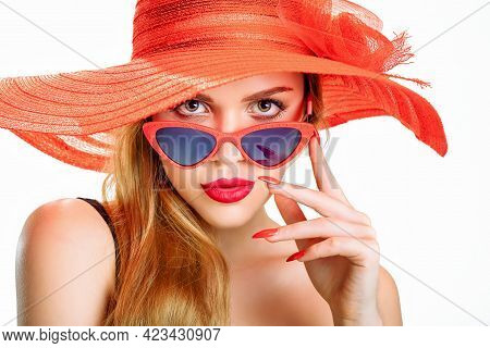 Young Beauty With A Red Straw Hat And Sun Glasses
