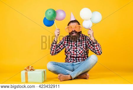 Holiday Celebration. Bearded Mature Man Celebrate Birthday Party. Cheerful Man In Bday Hat Hold Holi