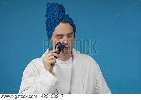 Handsome Young Sleepy Man With Closed Eyes Is Just Woke Up And Trying To Shave His Face With Electri