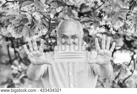 Senior Man Face Mask. Respiratory Mask. Pollen Allergen. Man And Flowers. Allergic Reaction. Limit R