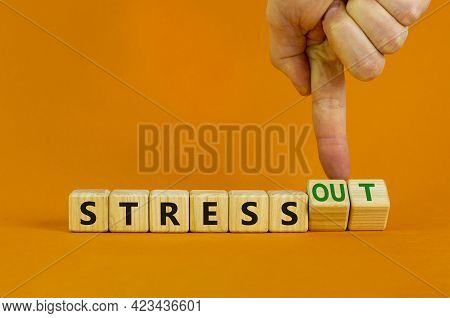 Stress Or Stress Out Symbol. Businessman Turns Cubes, Changes Words 'stress' To 'stress Out'. Beauti