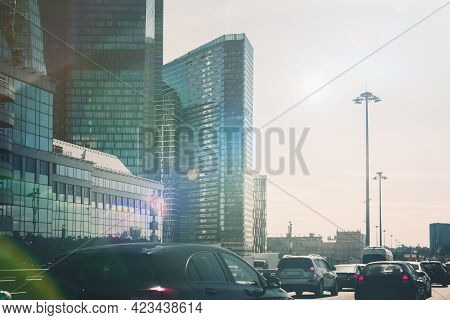 A Toned Image Of A Cityscape With Sun Flares. Car Traffic On The Road In Summer In Moscow. The Moder