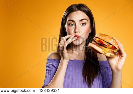 Girl Lick Fingers, Eats Delicious Cheeseburger. Women Having Office Lunch Break, Order Delivery, Hol