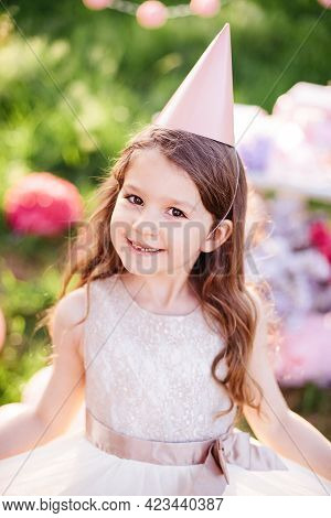 Happy Birthday Little Girl With Gift Box In Beautiful Garden. Child Eat Happy Birthday Rose Cupcake.