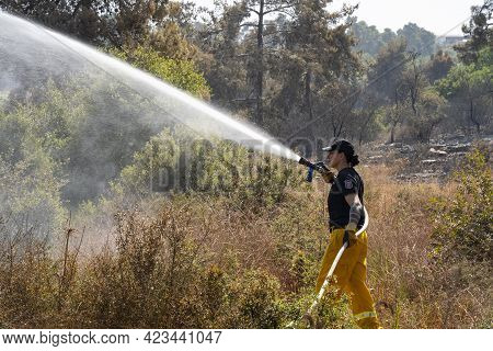 Maale Hahamisha, Israel - June 10th, 2021: An Israeli Fire Fighter Fighting A Large Forest Fire Near