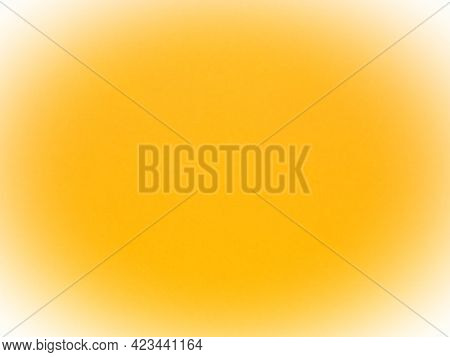Yellow Vivid Abstract Background. Beautiful Rich Yellow Color. White Vignetting Around The Edges.