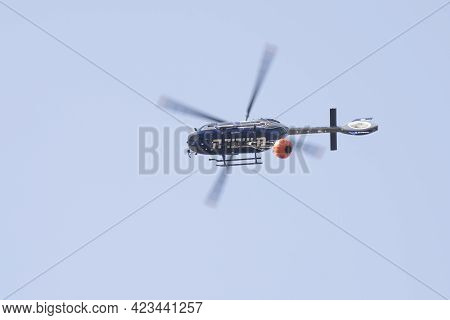 Maale Hahamisha, Israel - June 10th, 2021: An Israeli Police Helicopter, Equipped With A Water Conta