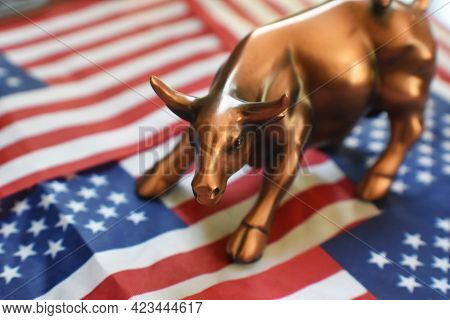 Bull Market Concept With Stock Market Bull On The American Flag