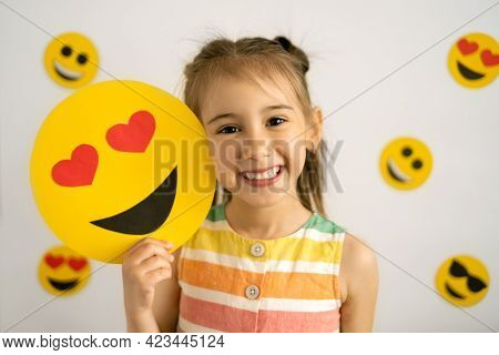World Emoji Day. Anthropomorphic Smile Face. Birthday Party. Emotions. A Little Girl, Smiling With A