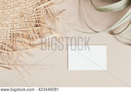 Blank business card decorated with woven and dried grass