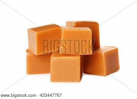 Many Caramel Cubes On White Background. Confectionery