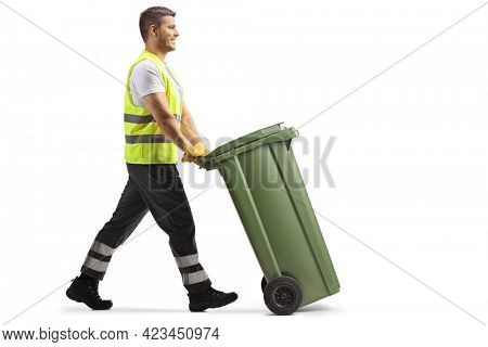 Full length profile shot of a waste collector pushing a plastic bin isolated on white background