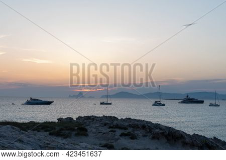 Fromentera, Spain : 2021 June 11 : Boats In  The Wonderful Sunset On The Beach Of Ses Illetes On The