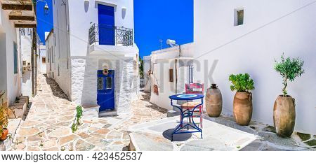 Beautiful Lefkes traditional greek village in Paros island. Charming coffe bars in narrow streets. Cyclades , Greece