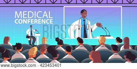 African American Male Doctor Giving Speech At Tribune With Microphone Medical Conference Medicine He