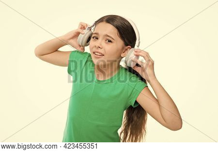 Kid Interested In Socialization. Children Use Headphones On A Daily Basis. Small Girl Listen To Musi