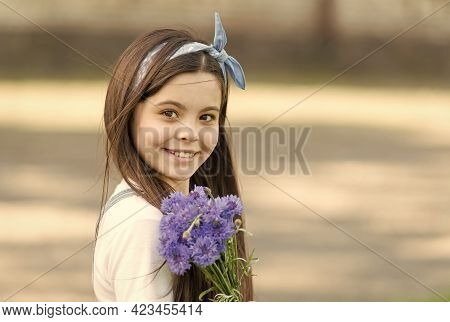 Holiday Flower Arrangements. Happy Girl Hold Cornflowers Outdoors. Holiday Celebration. Happy Birthd