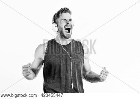 Finally. Unshaven Man Listening Music In Headset. Sexy Muscular Man Listen Sport Music. Man In Earph