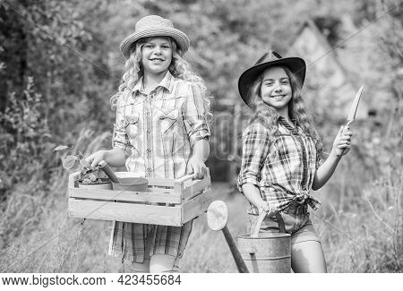Gardener Occupation. Taking Care Of Plants. Sisters Helping At Backyard. Girls With Gardening Tools.