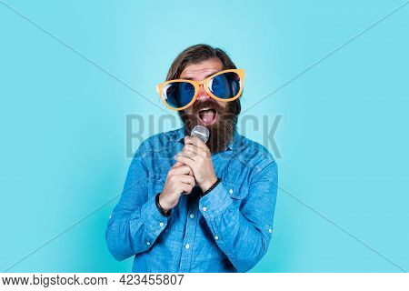 Favorite Song. Funny Party Glasses. Karaoke And Music. Male Speaker With Mic. Vocal. Happy Smiling M