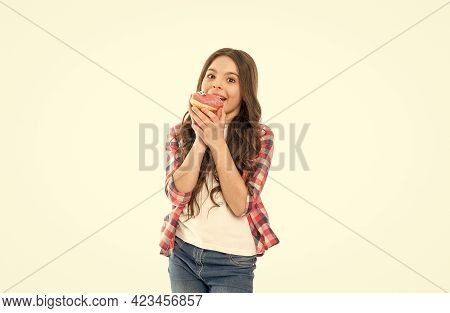 Appetite. Sweets For Your Kids. Girl Cute Smiling Face Holds Sweet Donut. Girl Likes Sweets Donuts.