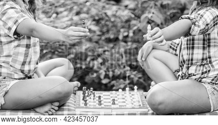 Play Chess. Sisters Playing Chess. Children Play Chess Outdoors Nature Background. Sport And Hobby C