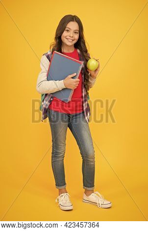 Eat Good Food To Be Cute. Happy Girl Hold Apple And Books. Brain Food. School Snack. Healthy Eating