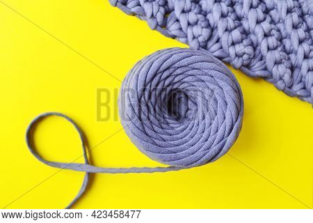 A Ball Of Gray Yarn(knitwear) And A Knitted Fabric On A Yellow Background Is A Layout Designed For C