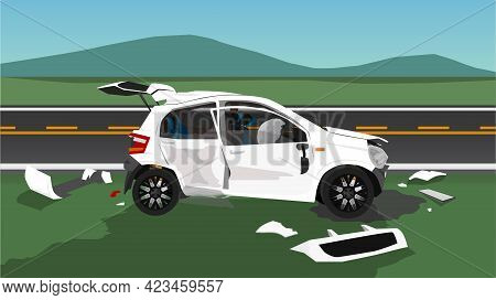 Accident Of White Hatchback Car Is Damaged On All Sides. Parked On The Roadside. Fragments Scattered