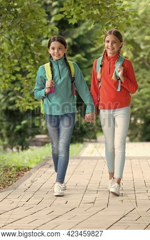 Family Values. Small School Girls Walking In Spring. Happy Childrens Day. Childhood Hapiness. Two Si
