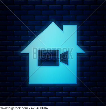 Glowing Neon Video Camera Off In Home Icon Isolated On Brick Wall Background. No Video. Vector