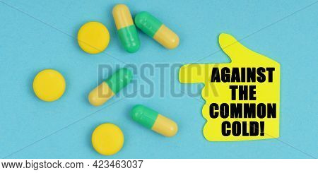 Medicine And Health Concept. On A Blue Background, There Are Pills And A Hand-sticker With The Inscr