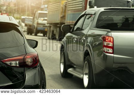 Rear Side Of Cars On The  Asphalt Road Driving On During Rush Hour. Drive Side By Side For Race. Blu