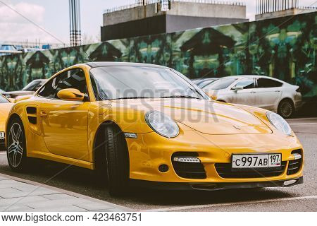 Moscow , Russia - May 2021: Luxury Sportscar Porsche 997 Turbo Yellow Color Parked Next To Moscow Ci