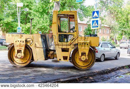 Samara, Russia - June 2, 2021: Road Roller Parked Up At The Sity Street.  Industry Of Roadwork Repai