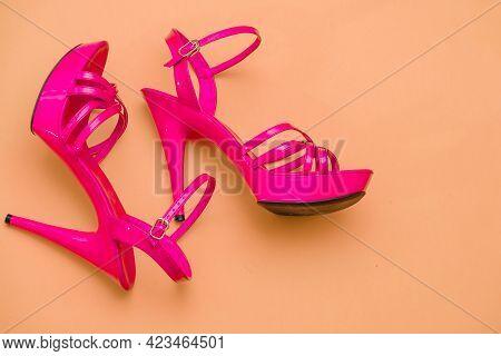 Beautiful Womens Shiny Patent Pink Stiletto Sandals On Orange Background